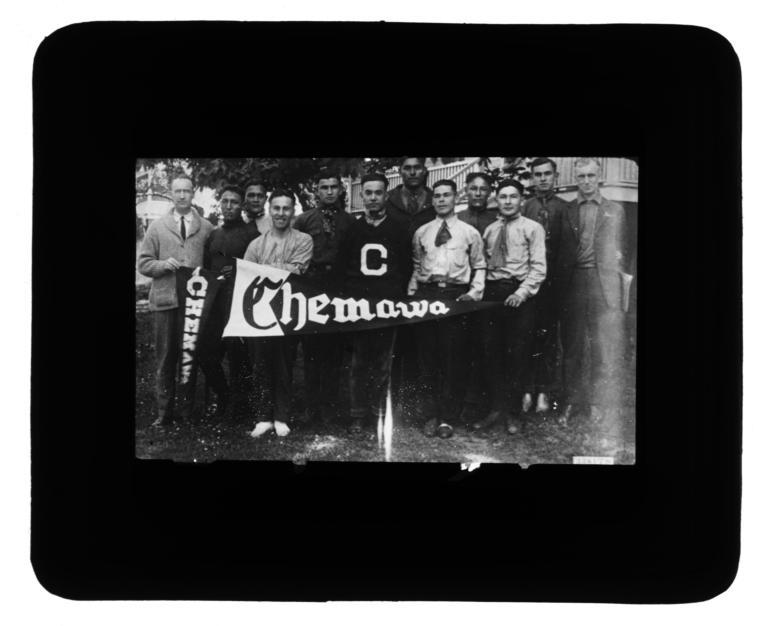 "Group of Men Displaying ""Chemawa"" Pennants"