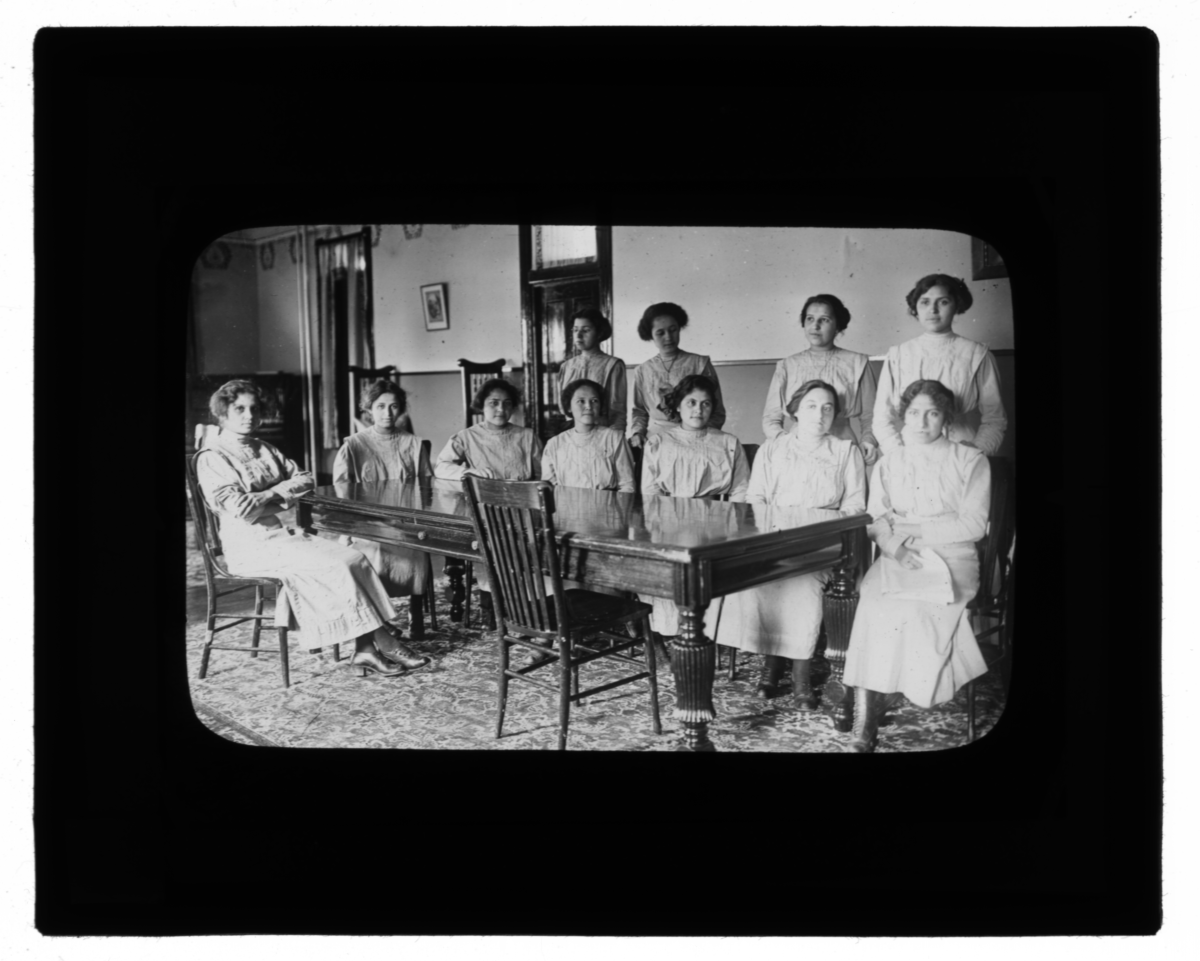Group of Women around a Long Table