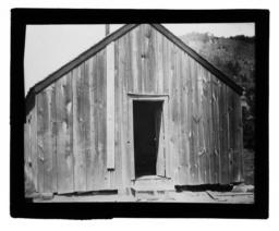 Wooden Building with an Open Door