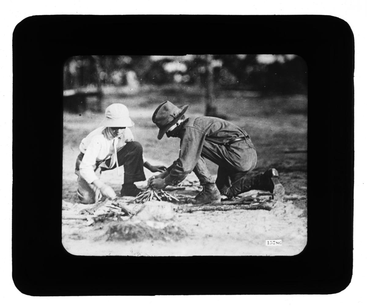 Two Young Boys Building Kindling for a Fire