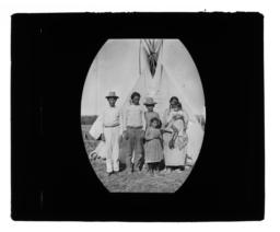 Small Group of Men, Women and Children in front of a Tipi