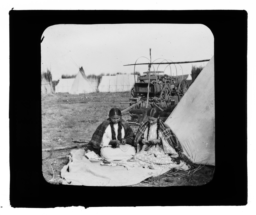 Two Young American Indian Women Making Something with Their Hands