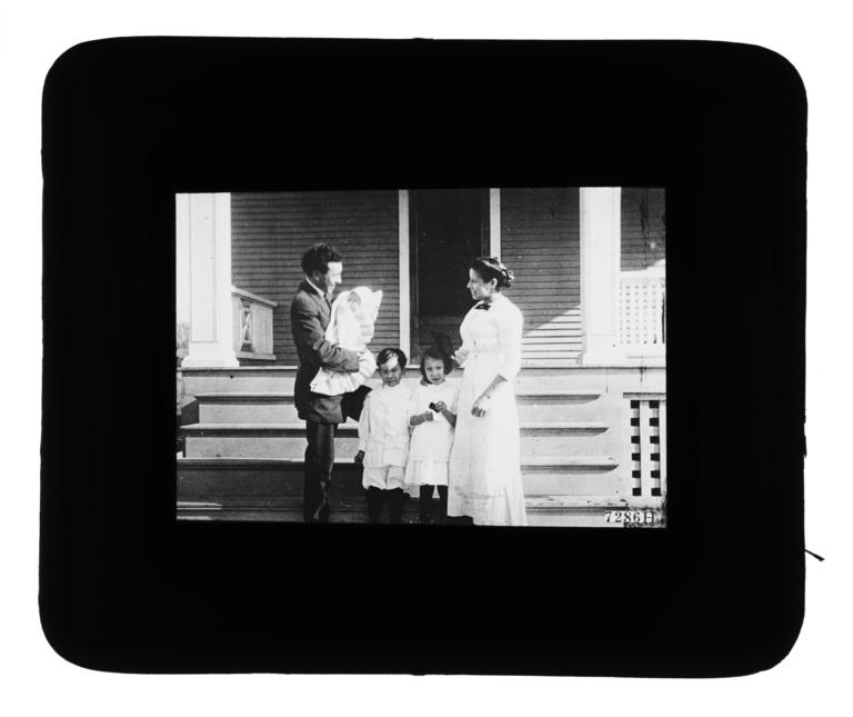 Woman, Two Young Children, and a Man Holding a Baby Wrapped in a Blanket