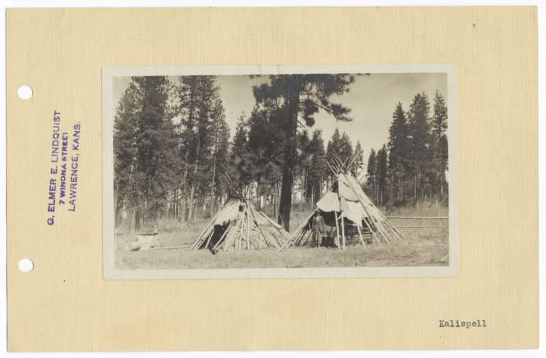 Two Tipis in a Clearing in front of a Forest Area