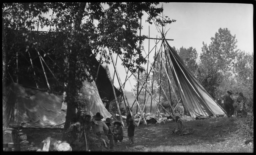 Semi-Covered Tipis with Kalispel Indian Adults and Children