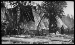 Semi-Covered Tipis with Indian Adults and Children, Idaho