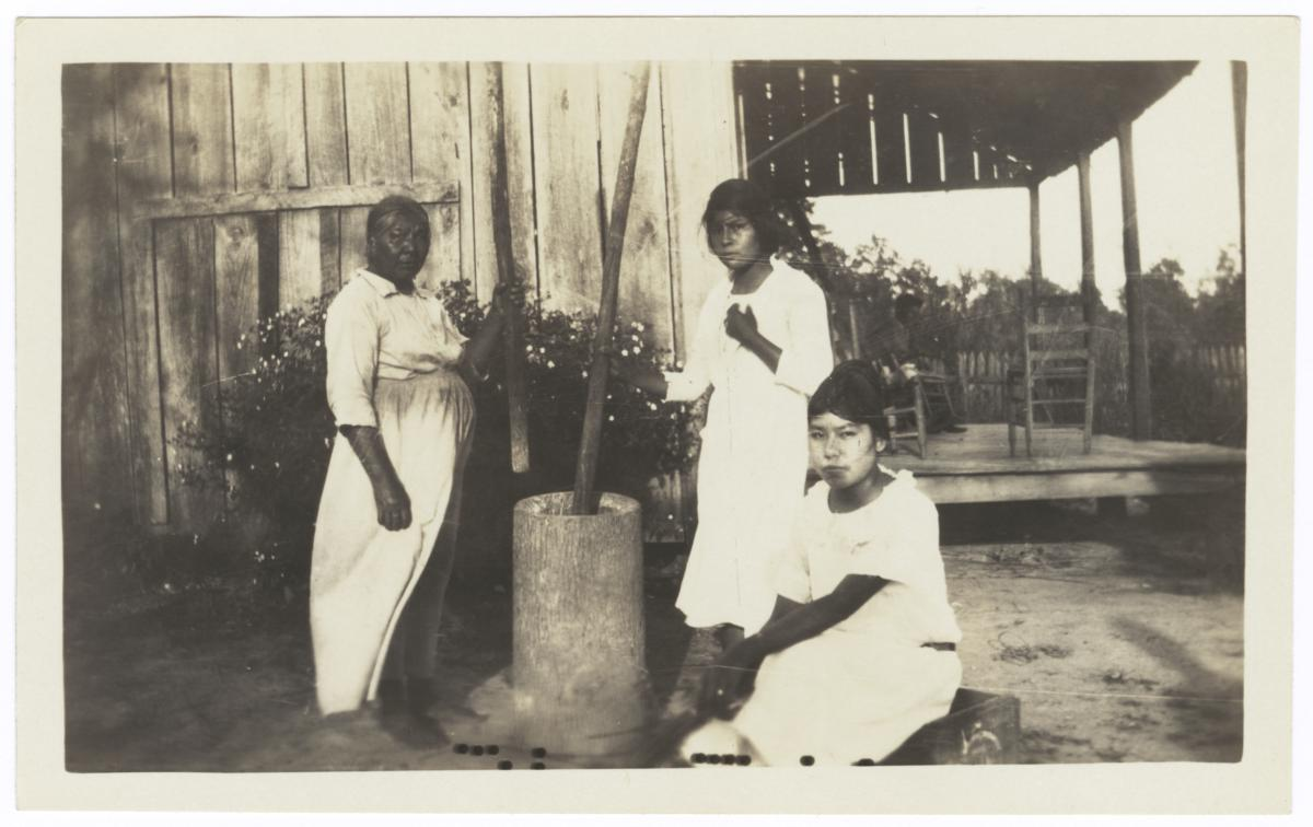 Three American Indian Women Pounding Corn in a Hominy Mortar