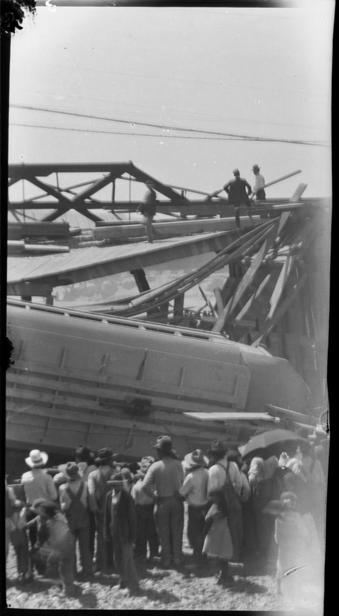 Crowds Looking at a Bridge Accident