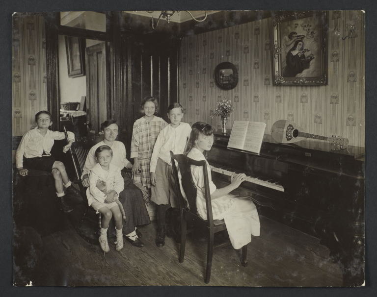 Family Around a Piano