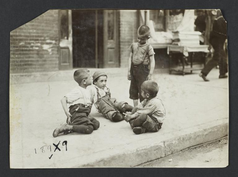 Boys Playing on Sidewalk