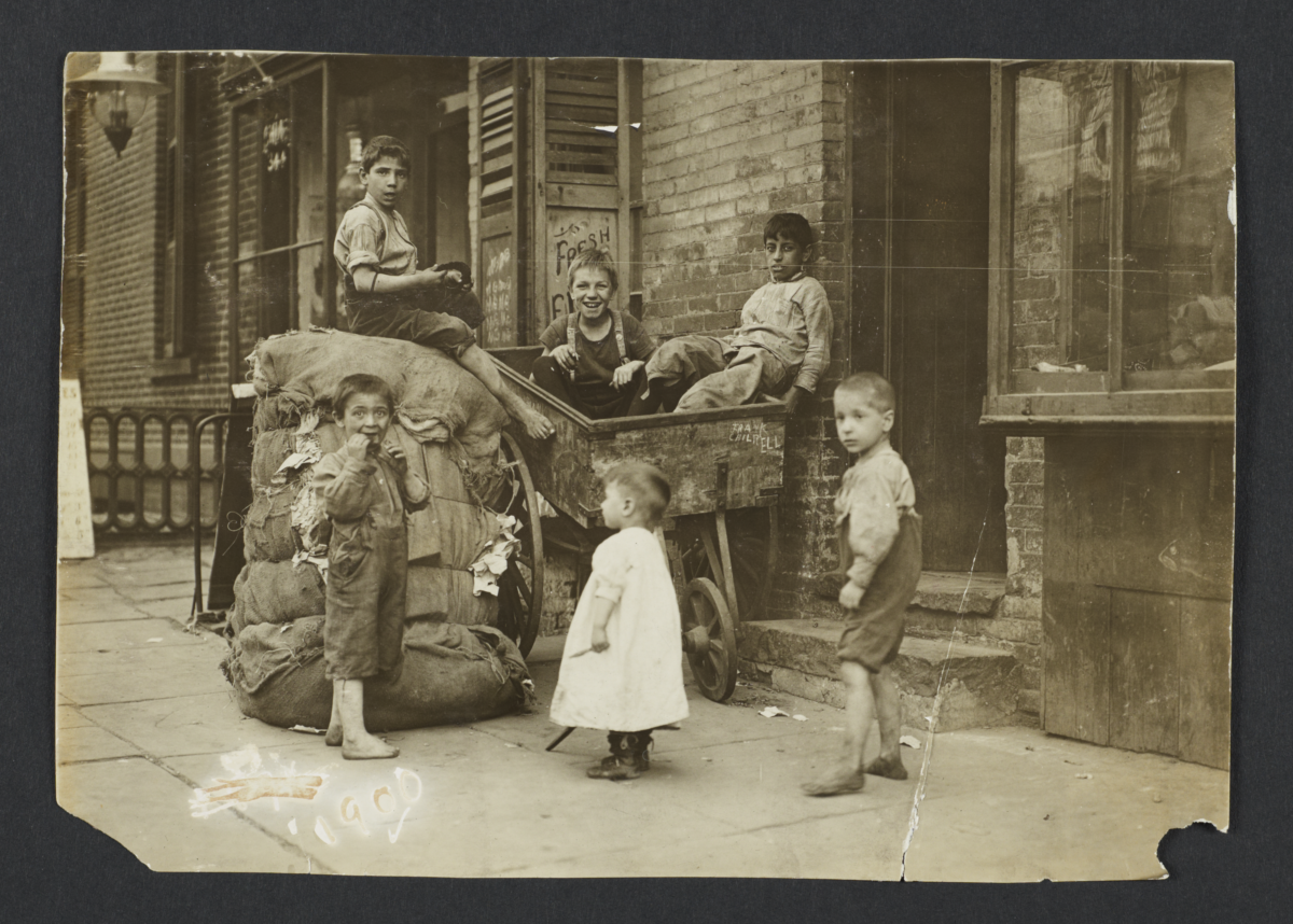 Children with Burlap Sacks and Wheelbarrow