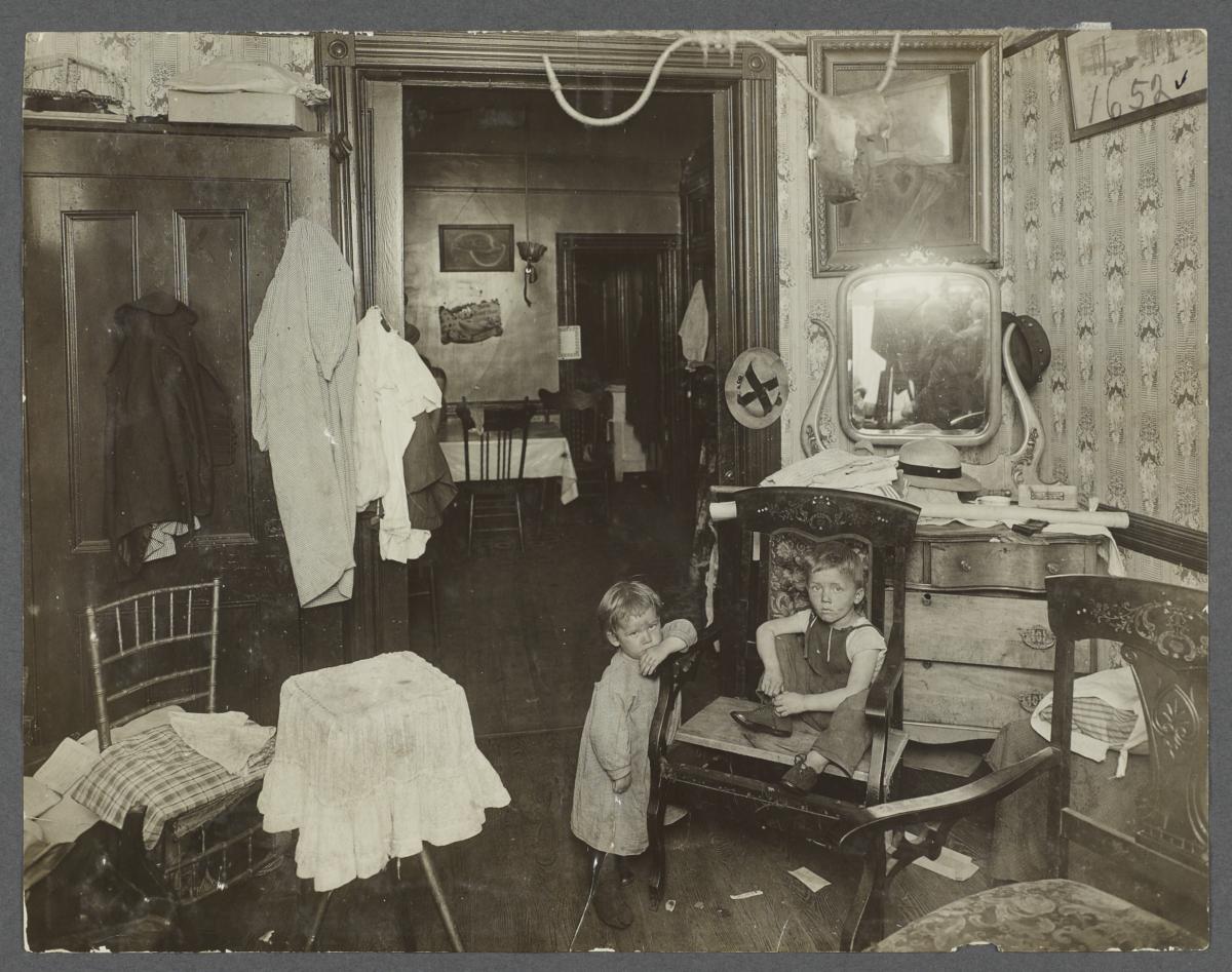 Two Children in Tenement Rooms