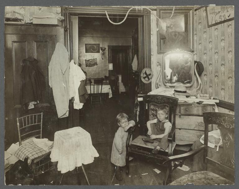 Two Children in Tenement Rooms