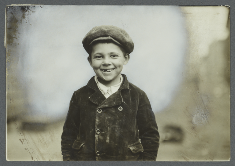 Boy in Cap with Front Teeth Missing
