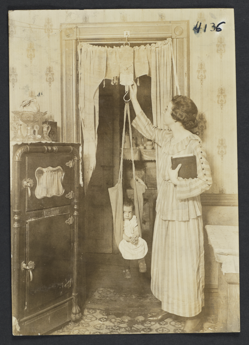 Mulberry Health Center Album -- Dietician Weighing Child
