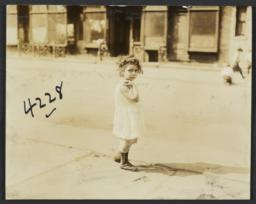 Little Girl on Sidewalk