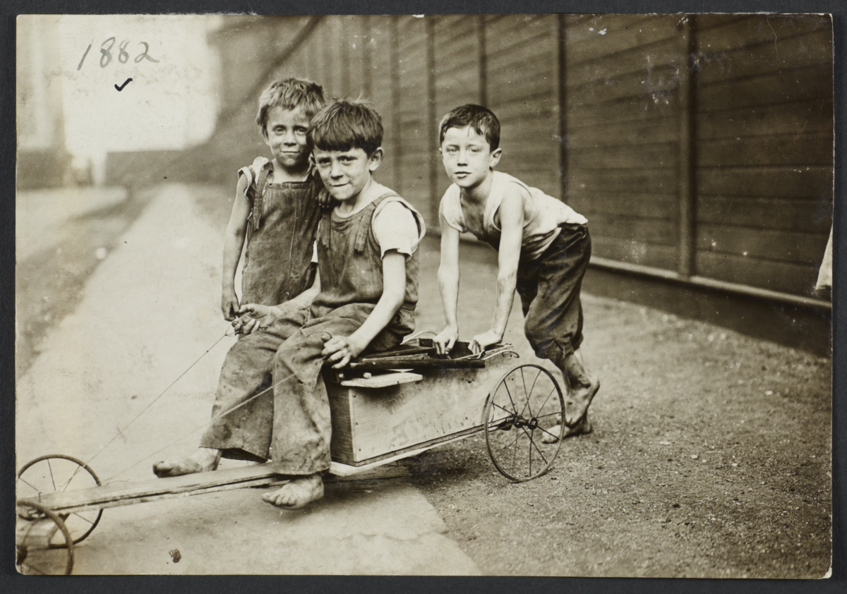 Three Children with Home-Made Scooter