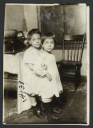 Two Children Beside a Stove