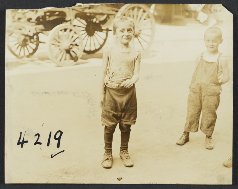 Two Boys, Buggy in Background