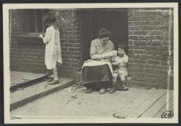 Woman Feeding Child