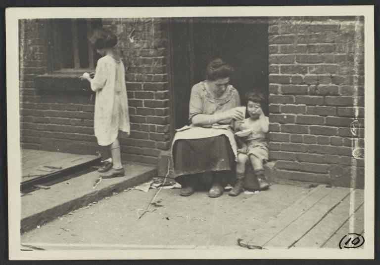 Woman Feeding Child