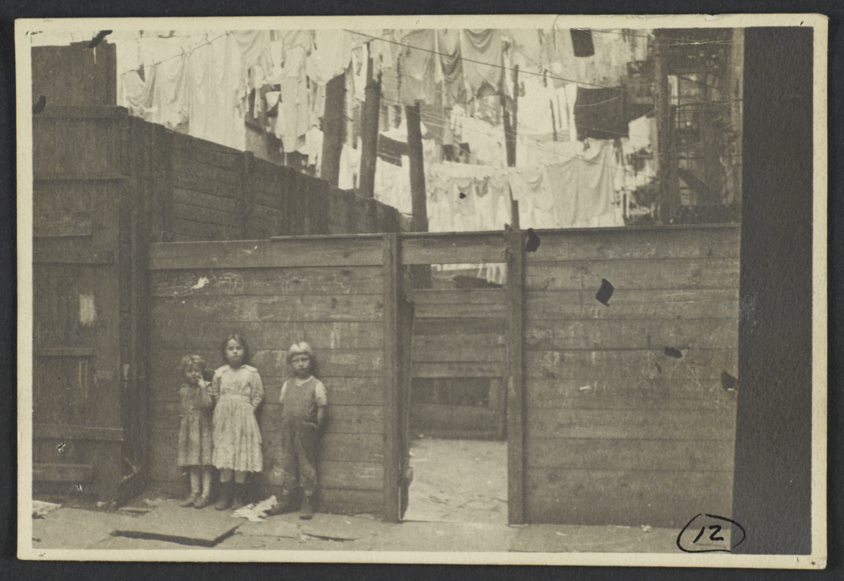 Three Children under Clotheslines