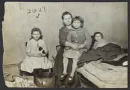 Mother and Three Children in Tenement Room
