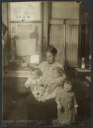 Seated Mother with Three Children