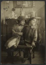 Two Children on Broken Chair