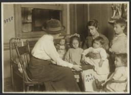 Mulberry Health Center Album -- Nurse with Mother and Children