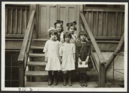 Mulberry Health Center Album -- Five Girls on Stairs