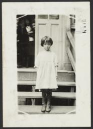 Mulberry Health Center Album -- Girl on Stairs