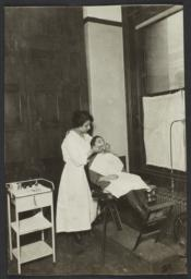 Mulberry Health Center Album -- Dental Hygienist with Girl