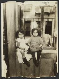 Two Little Girls on Windowsill