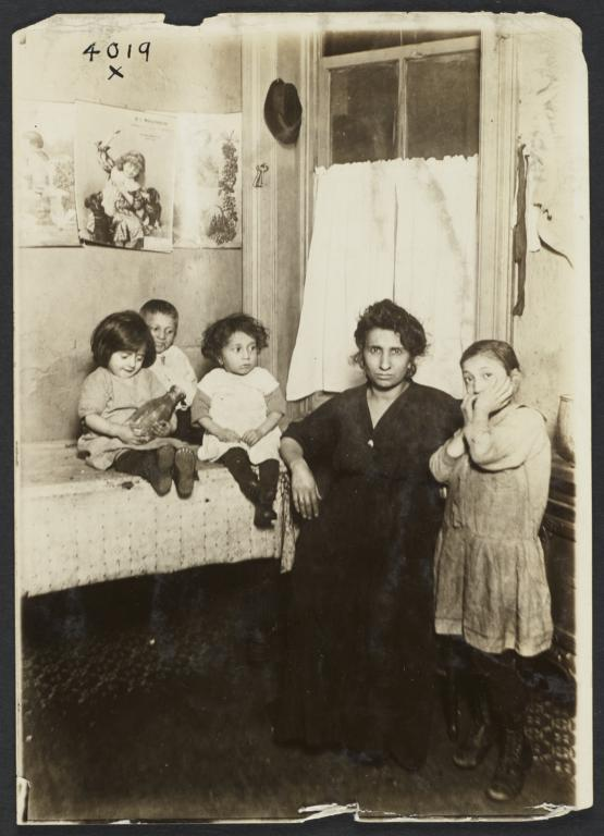 Woman with Four Children near Table