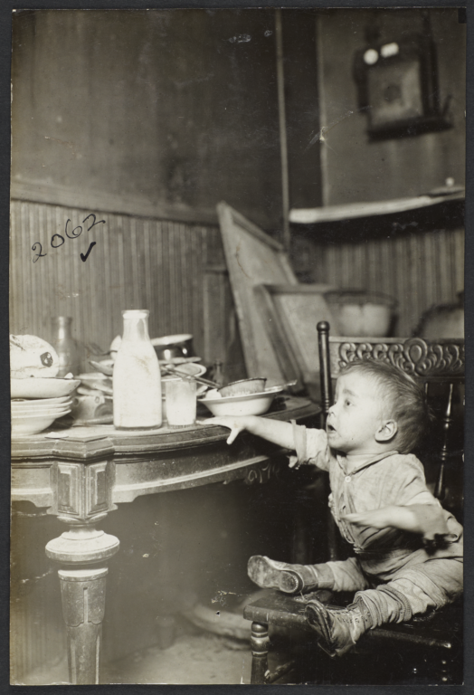 Child Reaching for Milk