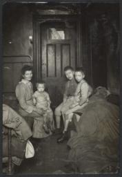 Mother with Three Children near Door