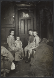 Mother with Three Children near Door