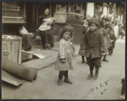 Little Girl with Children on Sidewalk