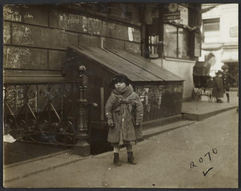 Girl on Sidewalk Wearing Hat and Coat