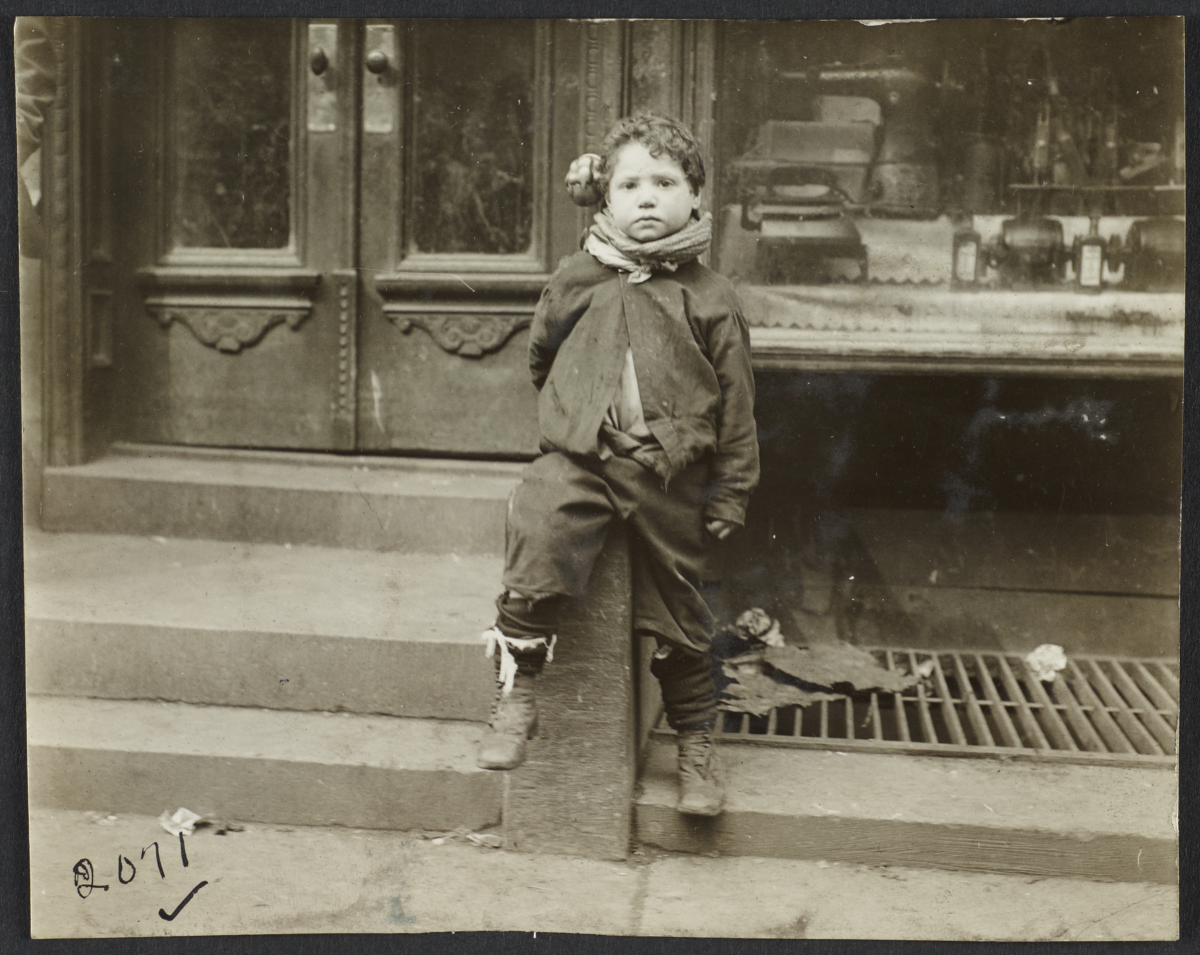 Boy Sitting on Stoop