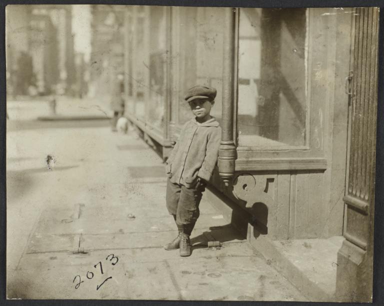 Boy Leaning against Window