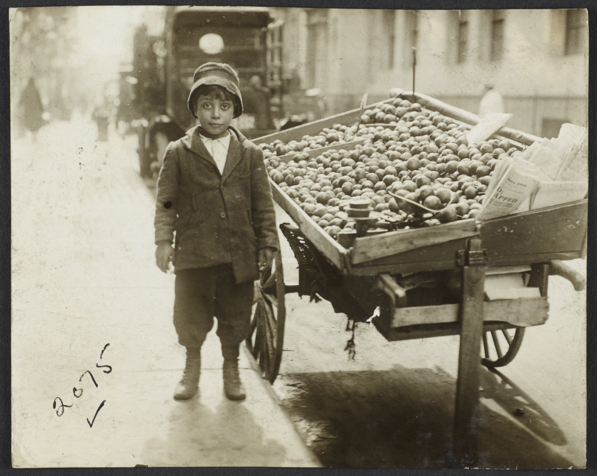 Boy near Fruit Stand