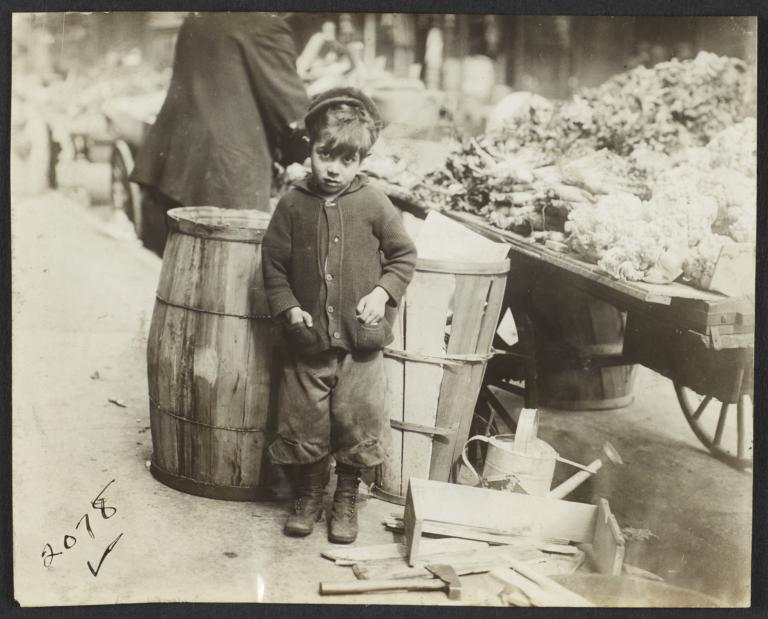 Boy near Barrels and Pushcart