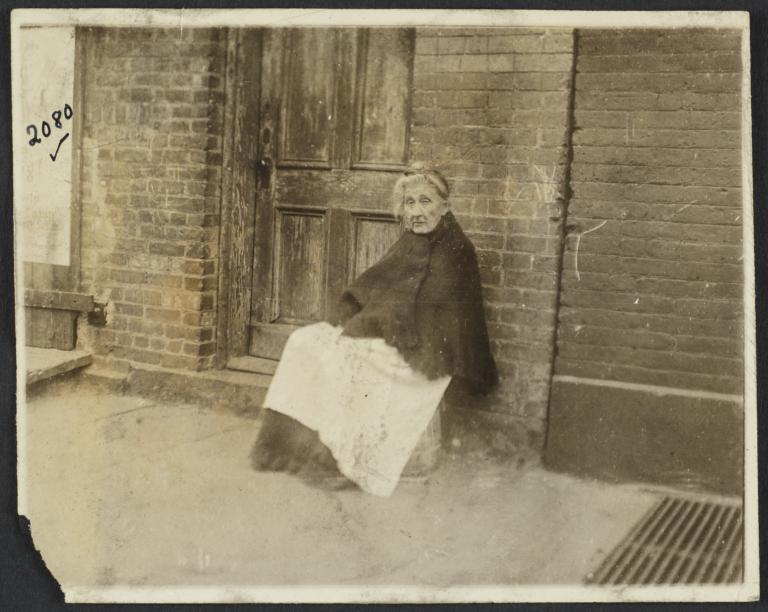 Old Woman Sitting near Door