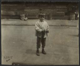 Boy Alone on Street