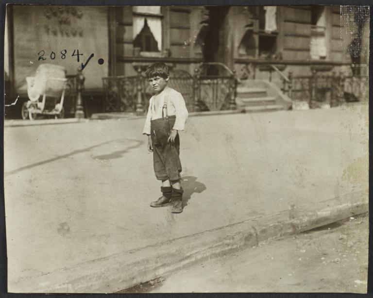 Boy Standing on Sidewalk