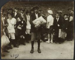 Boy with Package and Group of Children