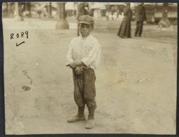 Boy on Street, Couple in Background