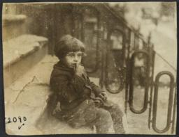 Child Sitting on Stoop
